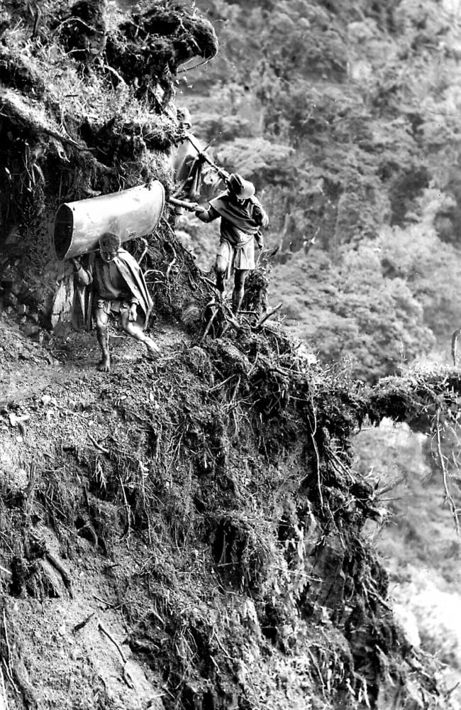 As it was ... an Aussie digger and local negotaite a tricky mountain path in PNG during WW2.