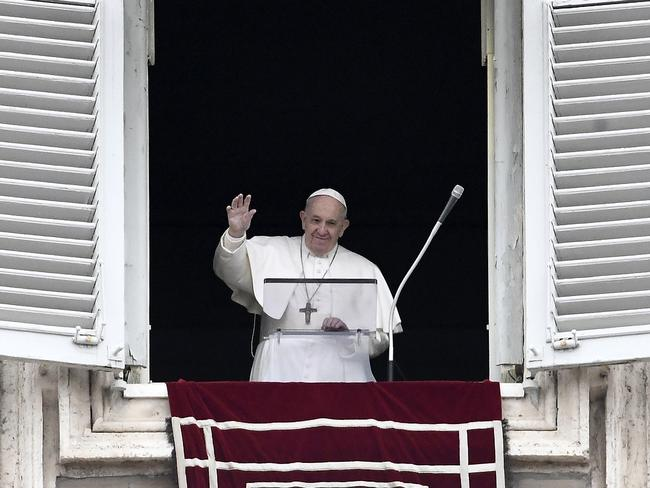Pope Francis waves to the faithful as he delivers the Sunday Angelus prayer from his studio window at the Vatican on March 1. Picture: Filippo Monteforte/AFP