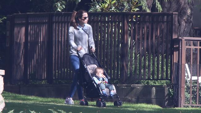 The Duchess of Cambridge pushes Prince George around the pristine grounds of Government House. Picture: News Corp