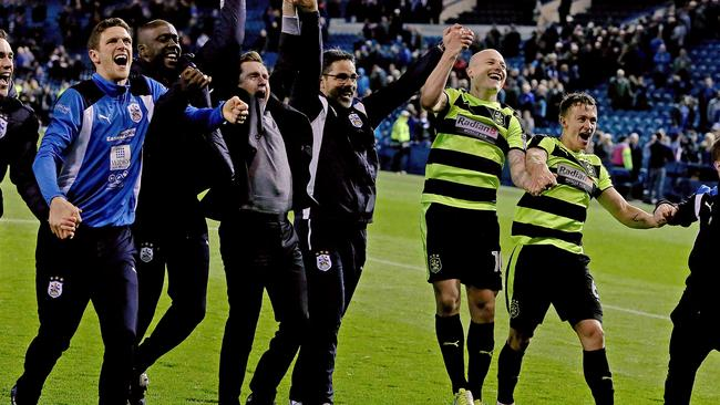 David Wagner, Manager of Huddersfield Town and his players celebrate/.