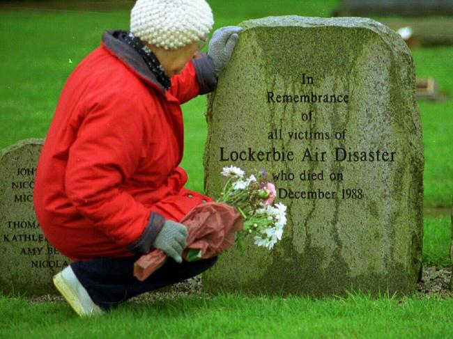 A woman pays her respect in the memorial garden for the Lockerbie victims on the tenth anniversary of the bombing, in 1998.