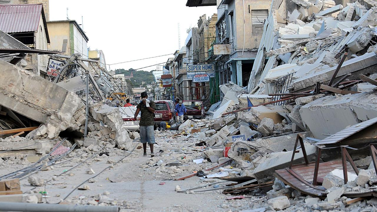 A man walks amid the rubble of destroyed buildings in Port-au-Prince following the earthquake that rocked Haiti on January 12, 2011. Picture: AFP