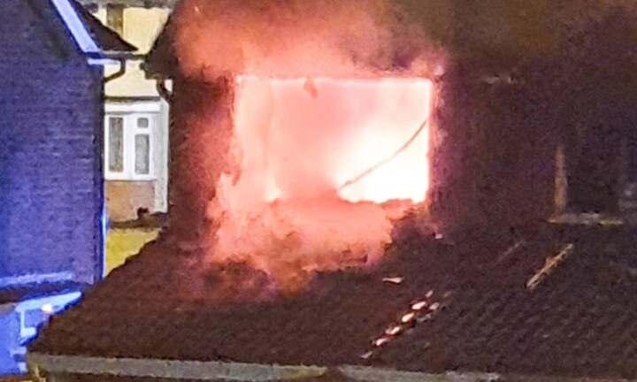 Terrifying moment dad escapes deadly house fire