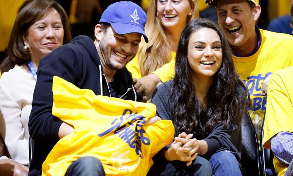 OAKLAND, CA - JUNE 05: (L-R) Actors Ashton Kutcher and Mila Kunis attend Game 2 of the 2016 NBA Finals between the Golden State Warriors and the Cleveland Cavaliers at ORACLE Arena on June 5, 2016 in Oakland, California. NOTE TO USER: User expressly acknowledges and agrees that, by downloading and or using this photograph, User is consenting to the terms and conditions of the Getty Images License Agreement. (Photo by Ezra Shaw/Getty Images)