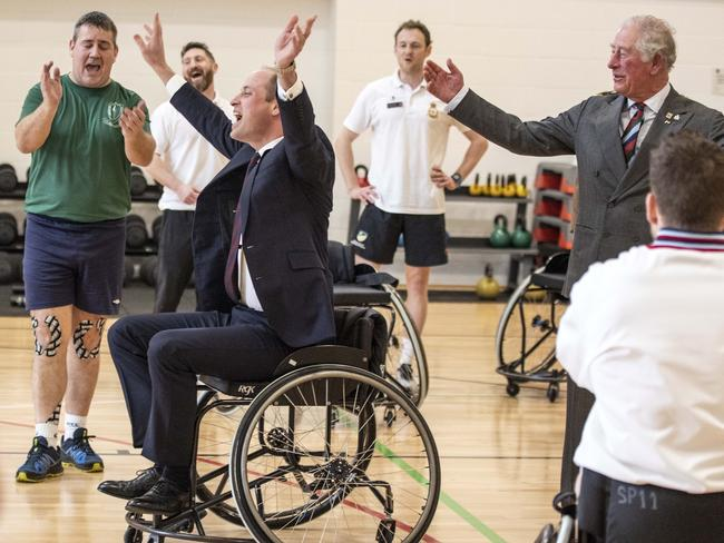 Prince William, Duke of Cambridge celebrates after the basket ball he threw from a wheel chair went into the hoop during a visit to the defence medical rehabilitation centre. Picture: Richard Pohle - WPA Pool/Getty Images
