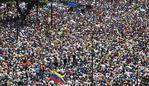 TOPSHOT - Anti-government demonstrators rally in Caracas to commemorate May Day on May 1, 2019 after a day of violent clashes on the streets of the capital spurred by Venezuelan opposition leader Juan Guaido's call on the military to rise up against President Nicolas Maduro. - Guaido called for a massive May Day protest to increase the pressure on President Maduro. (Photo by Federico PARRA / AFP)