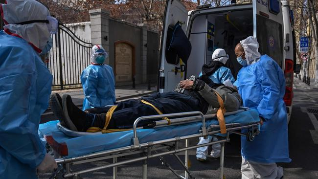 A patient being taken from an apartment suspected of having the deadly COVID-2019 coronavirus in Wuhan.