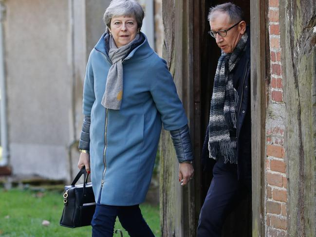 Britain's Prime Minister Theresa May (L) leaves with her husband Philip (R) after attending a church service, west of London on March 24, 2019. Picture: AFP