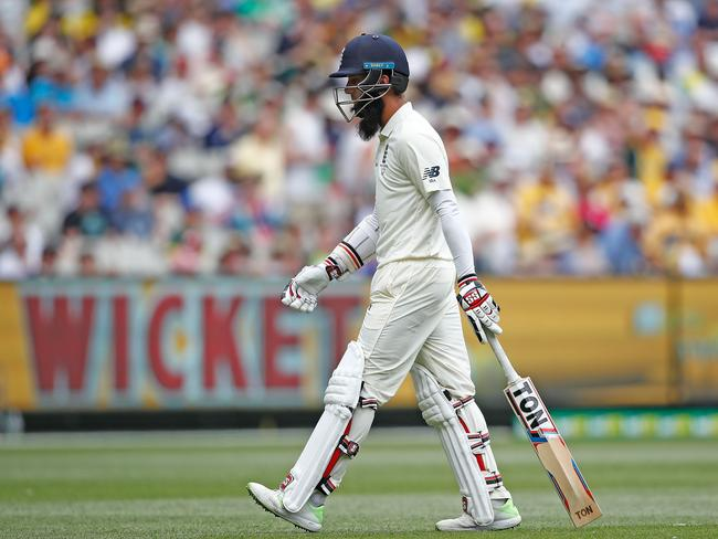 Moeen Ali of England leaves the field after being dismissed by Nathan Lyon at the MCG.