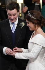 Princess Eugenie smiles as Jack Brooksbank put the ring on her finger during their wedding ceremony at St George's Chapel in Windsor Castle on October 12, 2018 in Windsor, England. (Photo by Danny Lawson - WPA Pool/Getty Images)