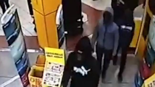 The teens enter the JB Hi-Fi at Taren Point calmly before ransacking the store. Picture: Channel 7