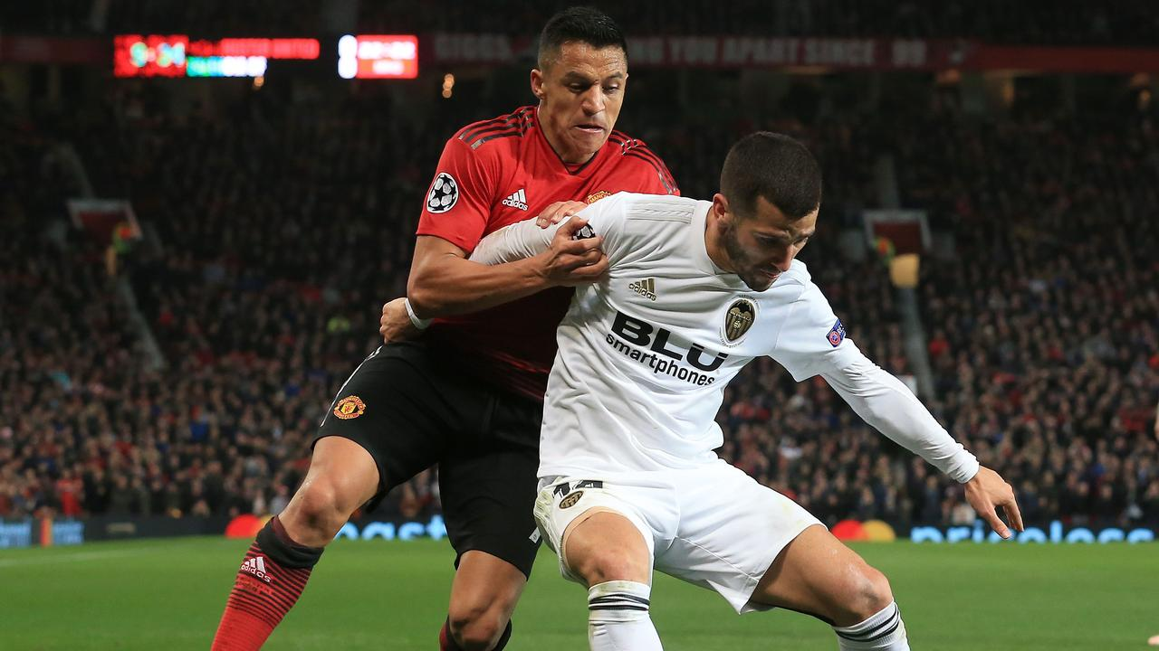 Manchester United's Chilean striker Alexis Sanchez (L) vies with Valencia's Spanish defender Jose Luis Gaya Pena