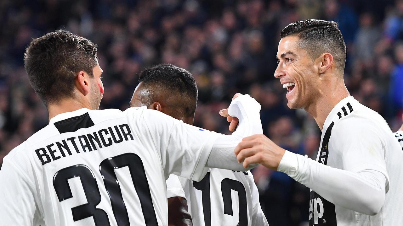 Juventus' Cristiano Ronaldo, right, celebrates after scoring