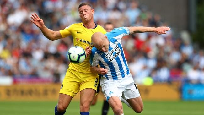 Huddersfield's Aaron Mooy gets his head to the ball ahead of Chelsea's Ross Barkley last weekend.