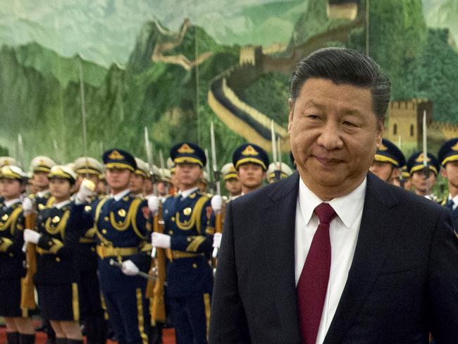 Chinese President Xi Jinping reviews an honour guard. Picture: AP