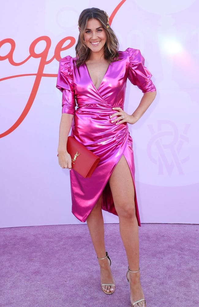 Georgia Love has led the celebrity arrivals at Melbourne Cup 2019 in a metallic pink dress. Picture: Matrix