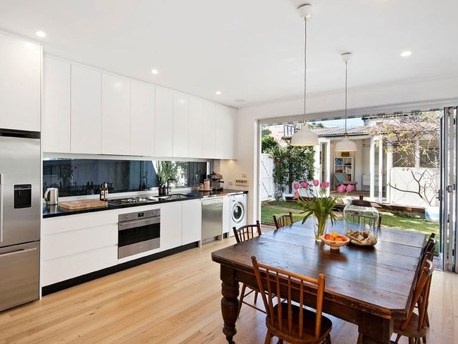 The owners of 2 Vicars Ave, North Bondi, had opened up the living area and added bi-fold doors.