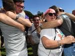 People celebrate after watching the same sex marriage vote result announcement during a picnic held by the Equality Campaign at Prince Regent Park in Sydney, Wednesday, November 15, 2017. Picture: AAP Image/David Moir