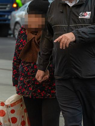 The same woman after police swooped. Picture: Jason Edwards