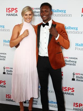 Adesanya arrives with New Zealand rower Beth Ross. (Photo by Fiona Goodall/Getty Images)