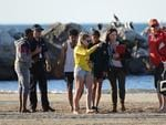 Rescuers look for the girl missing off Glenelg. Picture: AAP / Brenton Edwards