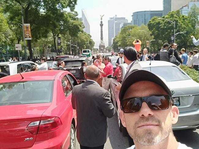 Australian Adam Williams rushed down into the street after a quake rattled his hotel in Mexico City. Picture: Supplied