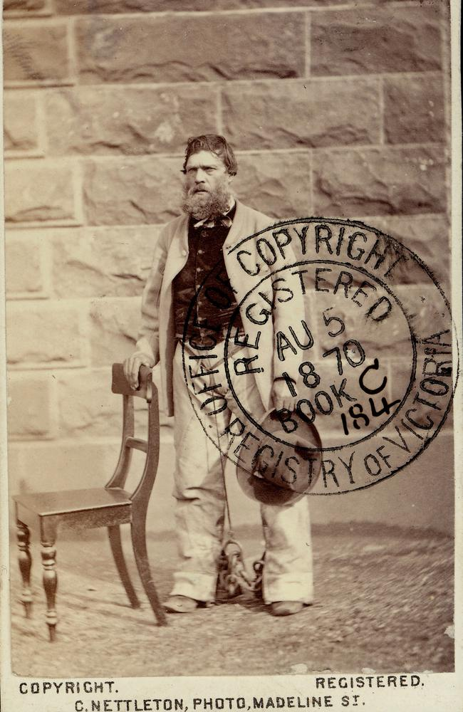 Harry Power standing in front of a wall in Pentridge Prison in 1870. Picture: State Library of Victoria