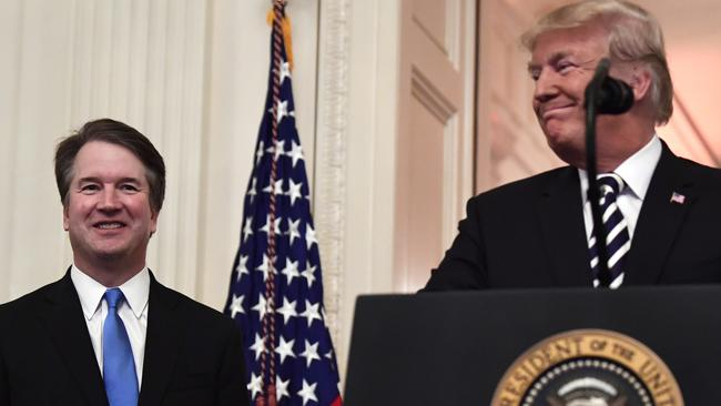 President Donald Trump, right, smiles as he stands with Supreme Court Justice Brett Kavanaugh. Picture: AFP