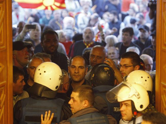 Police tried to block the protesters from entering the parliament building but were overwhelmed.