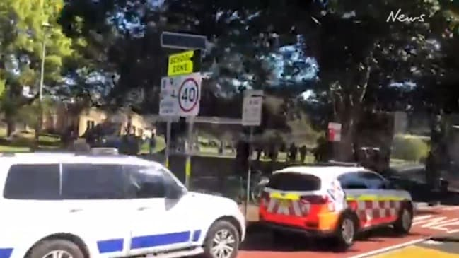 Car ploughs into bus stop