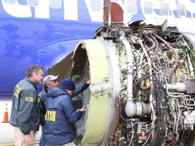 Investigators on scene examining damage to the engine of the Southwest Airlines plane. Picture: AFP/National Transportation Safety Board