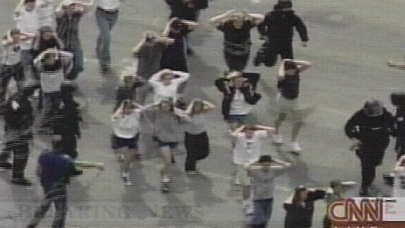 April 20. 1999: Students being led to safety by police after being evacuated from the school. Picture: CNN