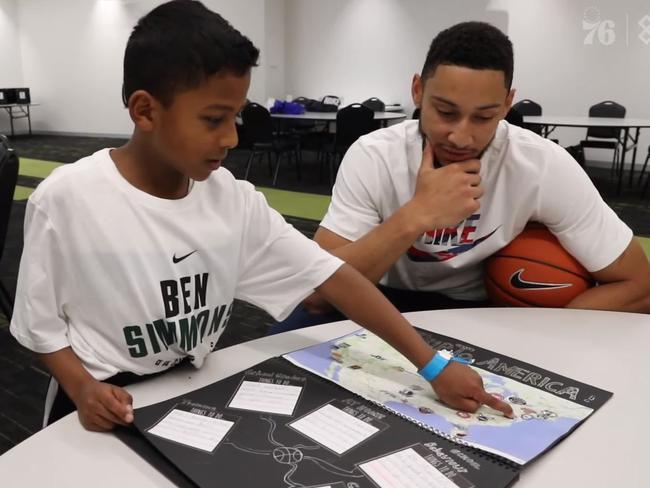 Eli shows Ben Simmons his NBA home work.