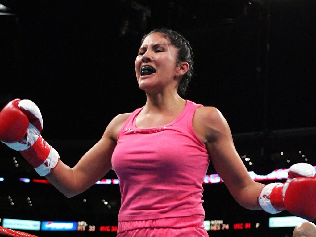 LOS ANGELES - DECEMBER 18: Mia St. John celebrates defeating Janae Romero Archuleta by TKO in the first round in the bout on December 18, 2004 at Staples Center in Los Angeles, California. (Photo by Robert Laberge/Getty Images)
