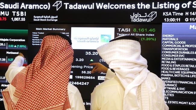 Saudi stock market officials pictured after the debut of Aramco's initial public offering on Riyadh's stock market. Picture: Photo/Amr Nabil