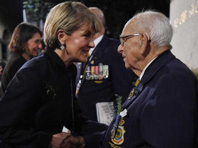 Australian Foreign Minister Julie Bishop with 95 year old Wal Scott-Smith, who retired today after being Custodian of the Cenotaph in Sydney's Martin Place for the past 78 years. Picture: AAP Image/David Moir