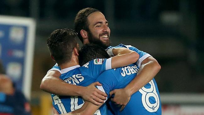 Higuain (C) celebrates after scoring with his teammates.
