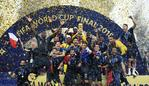 (FILES) In this file photo taken on July 15, 2018 France's players celebrate as they hold their World Cup trophy during the trophy ceremony at the end of the Russia 2018 World Cup final football match between France and Croatia at the Luzhniki Stadium in Moscow. (Photo by FRANCK FIFE / AFP) / RESTRICTED TO EDITORIAL USE - NO MOBILE PUSH ALERTS/DOWNLOADS