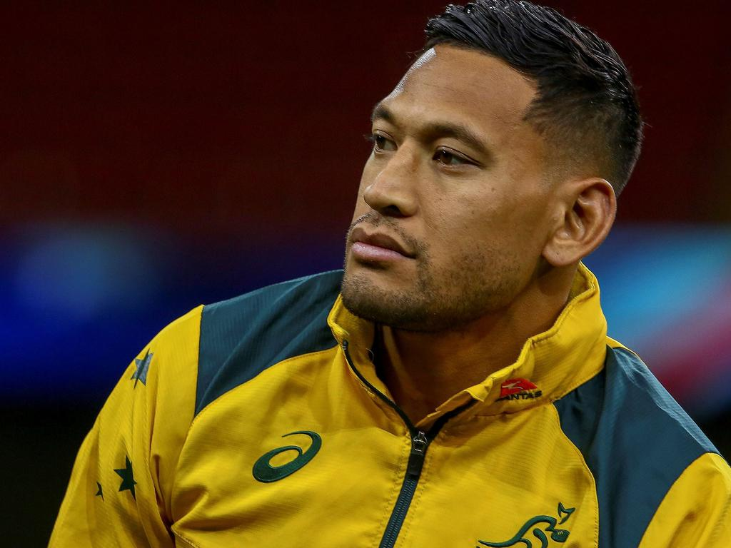 (FILES) In this file photo taken on November 9, 2018, Australia's wing Israel Folau attends the captain's run training session at the Principality stadium in Cardiff, south Wales, on the eve of their autumn international rugby union match against Wales. - Folau and Rugby Australia look headed for a long and costly court battle over his sacking for homophobic comments after last-ditch conciliation talks collapsed on June 28, 2019. (Photo by GEOFF CADDICK / AFP) / RESTRICTED TO EDITORIAL USE -use in books subject to Welsh Rugby Union (WRU) approval
