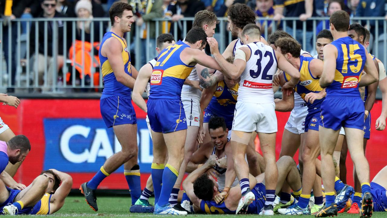Fremantle players dish out some justice to Andrew Gaff following his punch on Andrew Brayshaw.