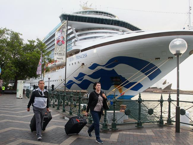 Passengers disembark from the Ruby Princess at the Overseas Passenger Terminal. Picture: Getty