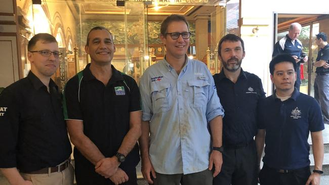 11/07/2018: Australian DFAT staff celebrate with Doctor Richard Harris (in light blue) and his dive buddy Craig Challen (next to him on the left) after they contributed the successful rescue of 12 soccer players and their coach from a cave in Thailand.