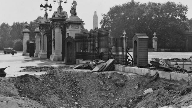 A crater and damaged railings outside Buckingham Palace, the result of explosions from a German airraid on September 13, 1940.  <i>Source: Getty Images</i>