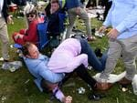 The two punters in their camping chairs barely bat an eyelid while this fight happened behind them. Picture:AAP Image/Joe Castro