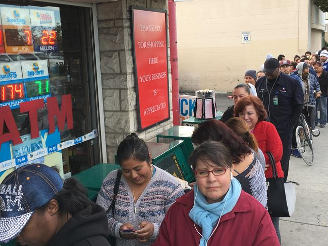 Scenes like this outside a California liquor store have been seen all across the US ahead of the record lottery draw. Picture: Damian Dovarganes/AP Photo