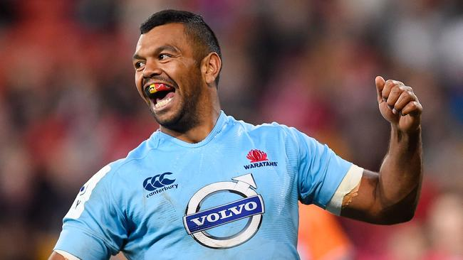 BRISBANE, AUSTRALIA - JULY 12: Kurtley Beale of the Waratahs celebrates after scoring a try during the round 19 Super Rugby match between the Reds and the Waratahs at Suncorp Stadium on July 12, 2014 in Brisbane, Australia. (Photo by Ian Hitchcock/Getty Images)