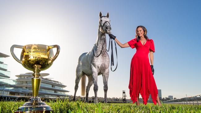 Megan Gale was at Flemington last year. She won't be back for Melbourne Cup Day this week. Picture: Jason Edwards