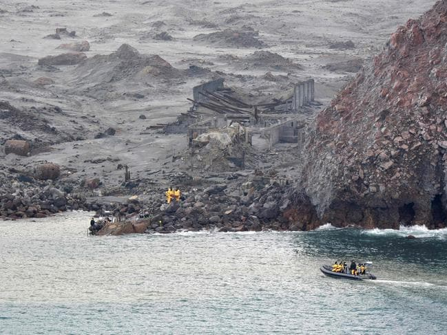 Navy divers were back searching for a seventh body off White island after SAS soldiers (above) recovered six on Friday in a daring mission. Picture: NZDF.