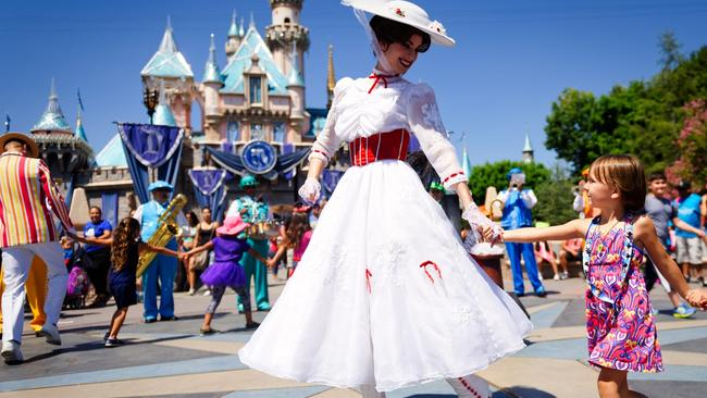 Mary Poppins smiles at a child outside Cinderella's castle, Disneyland. Picture: Supplied