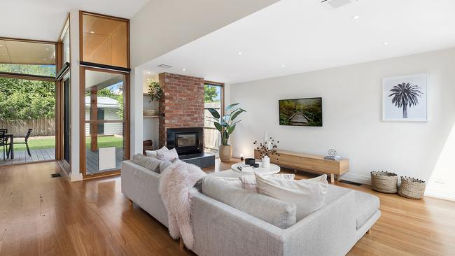 The open-plan living area leads to the private backyard.
